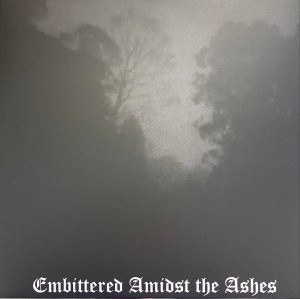 carved cross – embittered amidst the ashes